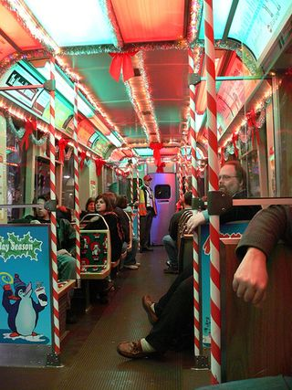 returning once again the ctas holiday train greets chicagos transit riders decorated inside and out with the seasons finery
